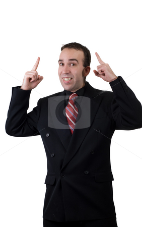 Businessman Pointing Up stock photo, A young businessman pointing up at something above his head by Richard Nelson