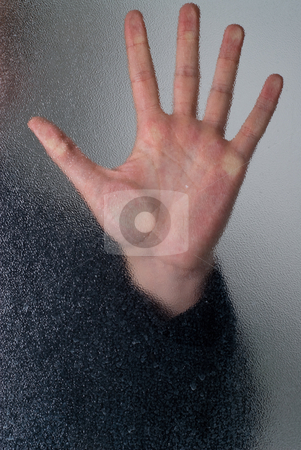 Trapped stock photo, Closeup of a hand pressed against some frosted glass by Richard Nelson