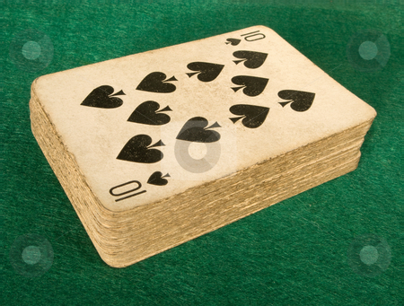 Old deck of cards on a green baize poker table. stock photo, Old deck of cards on a green baize poker table. by Stephen Rees