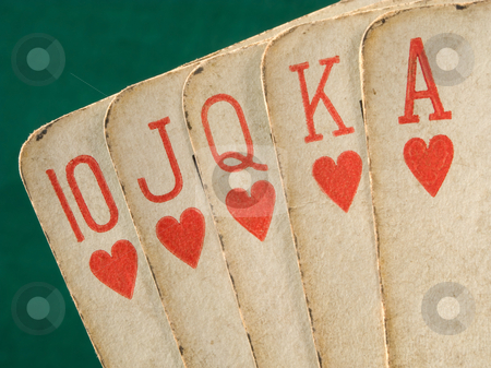 Royal flush hearts suit old vintage cards  close up. stock photo, Royal flush hearts suit old vintage cards  close up. by Stephen Rees