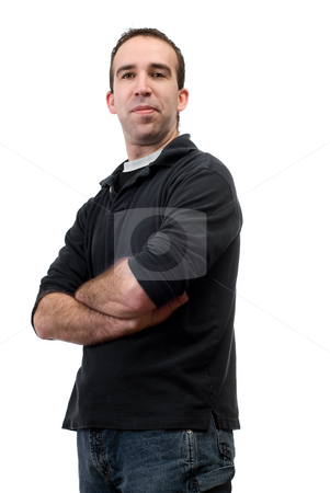 Isolated Casual Man stock photo, A young man dressed casually, standing with his arms crossed against a white background by Richard Nelson
