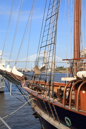Wooden sail Boat stock photo, Wooden sail boat moored to docks on the Savannah river with Talmadge bridge in the background by Jack Schiffer
