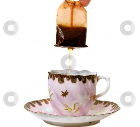 Dripping Tea Bag stock photo, Dripping tea bag in an antique tea cup. by Brett Mulcahy