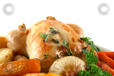 Roast Chicken And Vegetables stock photo, Whole roast chicken with potatoes pumpkin carrots and beans. by Brett Mulcahy