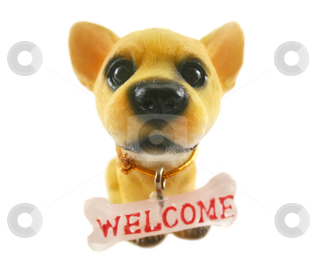 Welcome Dog stock photo, Cute ceramic dog with big head and welcome sign. by Brett Mulcahy