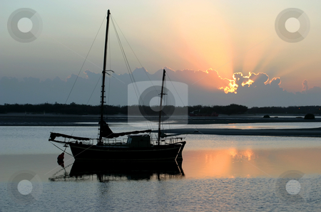 Sunrise Ketch stock photo, Ancient old ketch moored peacefully at sunrise. by Brett Mulcahy