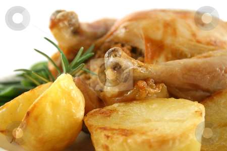 Chicken And Baked Potatoes stock photo, Chicken drumstick with fresh baked potatoes amd vegetables. by Brett Mulcahy