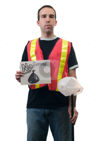 No Litter stock photo, Concept image of a garbage cleanup person holding a sign that says no litter by Richard Nelson