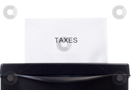 Eliminating Taxes stock photo, Closeup view of a single paper with the word taxes on it, going through the shredder by Richard Nelson