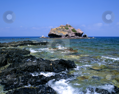 Holy rock stock photo, A small island close to the Baths of Aphrodite in Cyprus by Paul Phillips