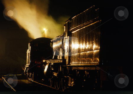 Night train stock photo, Vintage steam train with gold lighting by Paul Phillips