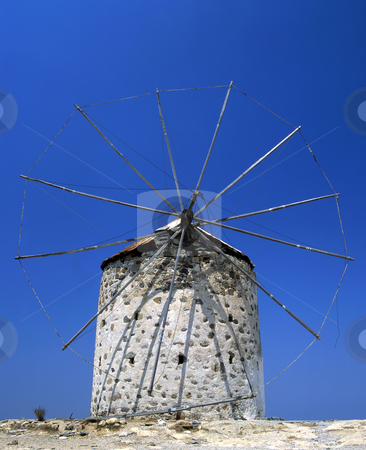 Derelict windmill stock photo, A derelict windmill on the Greek Island of Kos with blue sky by Paul Phillips