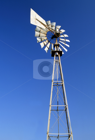 Irrigation windmill stock photo, An irrigation wind pump against a blue sky by Paul Phillips