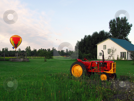 Hot Air Balloons and Tractor stock photo, Hot Air Balloons over a field and an old tractor by Alain Turgeon