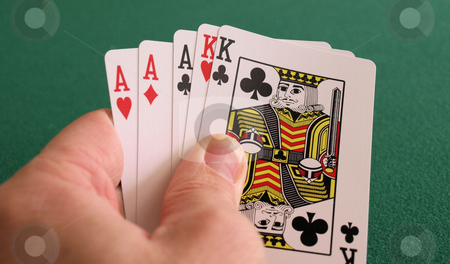 Big hand stock photo, A great poker hand with aces and kings by Tim Markley