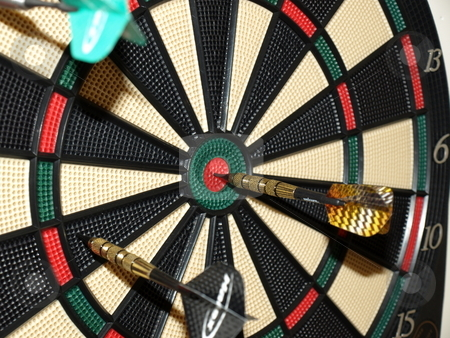On target stock photo, Darts thrown at the board with one bullseye by Tim Markley