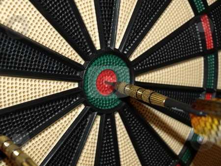 Dead center stock photo, A dart thrown at dead center of the board by Tim Markley