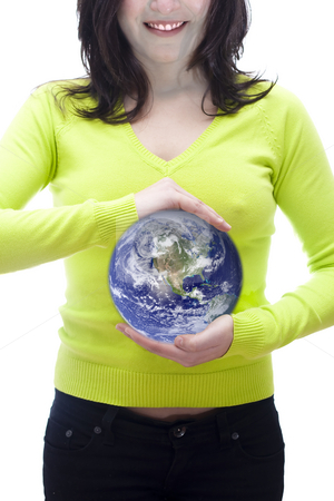 World in your hands stock photo, Conceptual image of the world in the hand of a woman by Paulo Resende