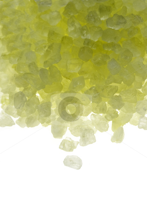 Bath salt crystals stock photo, Yellow bath salt crystals over white background by Francesco Perre