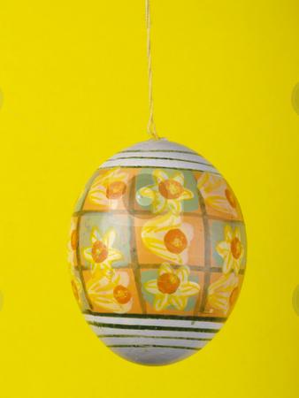 Easter egg stock photo, Handpainted easter egg over yellow by Torsten Lorenz