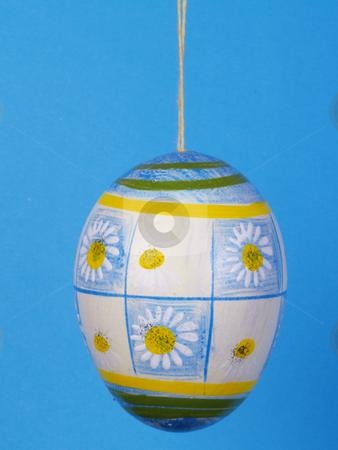 Easter egg stock photo, Handpainted easter egg over blue by Torsten Lorenz