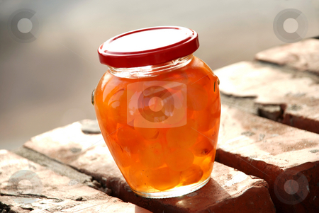 Jar with jam stock photo, Glass jar with white cherries close up by Julija Sapic