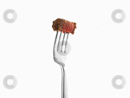 Steak on a fork stock photo, Steak on a fork with white background by John Teeter