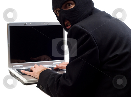Hacker stock photo, A hacker is using a laptop computer to steal information, isolated against a white background by Richard Nelson