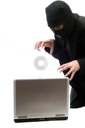 Hacker stock photo, A hacker about to break into a portable computer, isolated against a white background by Richard Nelson