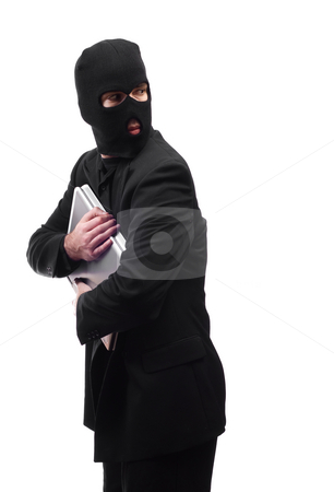 Thief Looking Over Shoulder stock photo, A thief holding a laptop is getting paranoid and looking over his shoulder, isolated against a white background by Richard Nelson