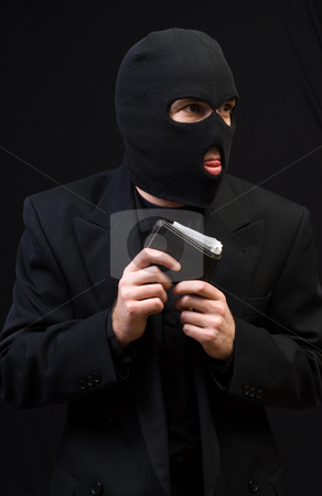 Wallet Thief stock photo, A wallet thief wearing a black balaclava and holding a leather wallet by Richard Nelson