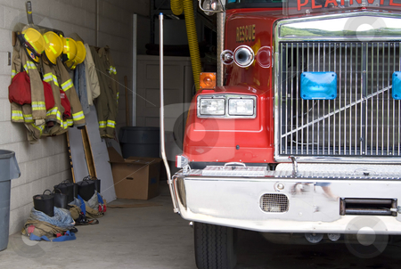 Fire Truck stock photo, A fire truck is parked in the bay with all of the fire fighting equipment and gear ready to go. by Todd Arena