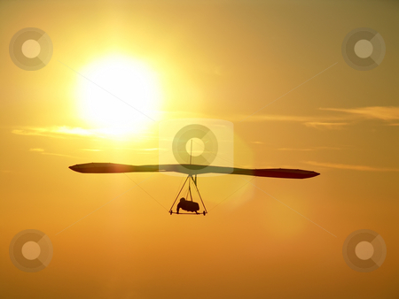 Sunset and freedom stock photo, Picture of a gliding taked from back to the sunset sun. by Matteo Malavasi