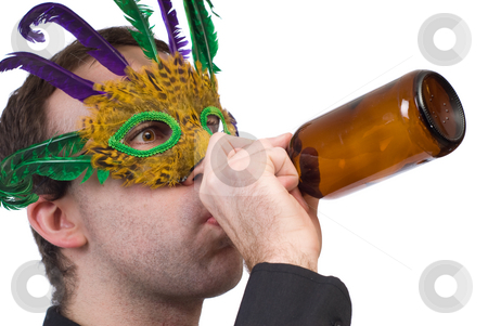 Party Man stock photo, Closeup view of a man wearing a feather mask drinking from a beer bottle, isolated against a white background by Richard Nelson