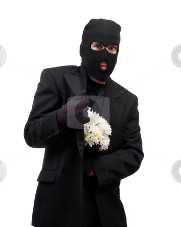 Stealing Flowers stock photo, A thief wearing a black suit and a balaclava is stealing a bouquet of daisies by Richard Nelson