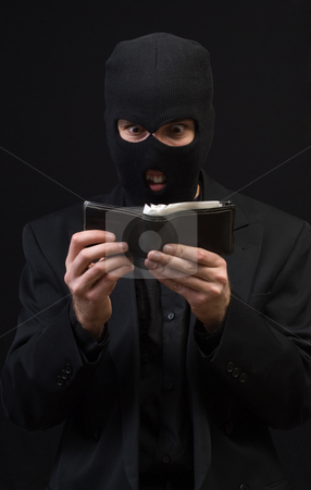 Pickpocket stock photo, Concept image of a pickpocket holding an open wallet by Richard Nelson