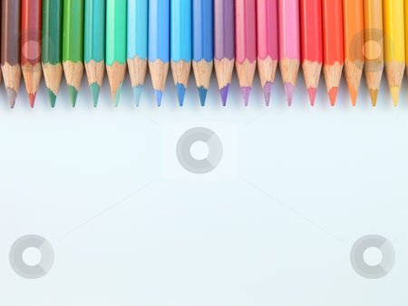 Crayons stock photo, Close up picture of a row of many colored  crayons by Matteo Malavasi