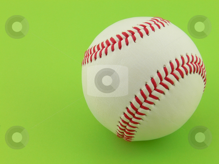 Baseball ball stock photo, Close up picture of a baseball ball on green background with copy space on left side by Matteo Malavasi