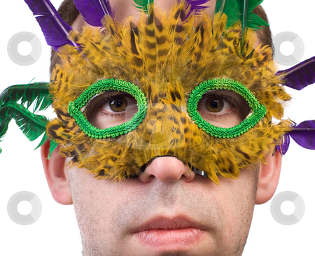 Man Wearing Feather Mask stock photo, Closeup view of a man wearing a feather mask, isolated against a white background by Richard Nelson