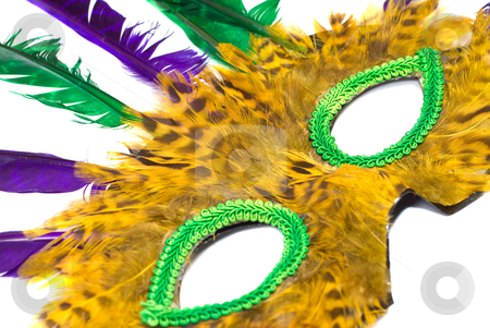 Mask stock photo, Closeup up view of a mask with feathers, isolated against a white background by Richard Nelson