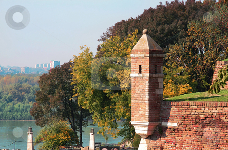 Details old stone fortress Kalemegdan in Belgrade stock photo, Brick tower over autumn trees in park Kalemegdan in Belgrade by Julija Sapic