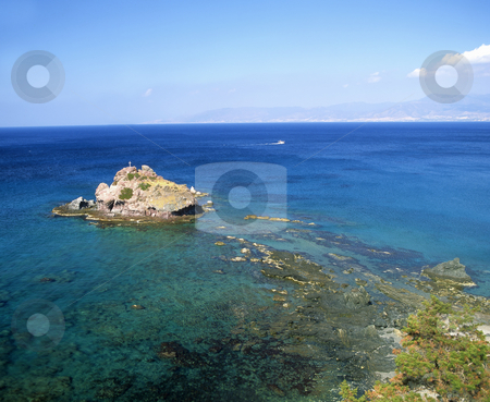 Near Aphrodite's rock stock photo, A small island close to the Baths of Aphrodite in Cyprus by Paul Phillips