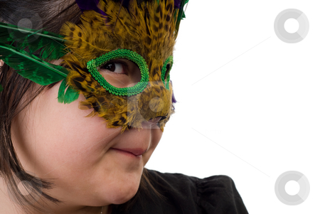 Dress-up stock photo, Closeup of a young girl playing dress-up and wearing a feather mask, isolated against a white background by Richard Nelson