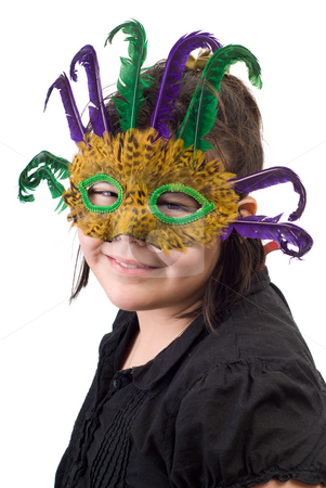 Costume Portrait stock photo, A young girl getting her portrait done while wearing a feather mask, isolated against a white background by Richard Nelson