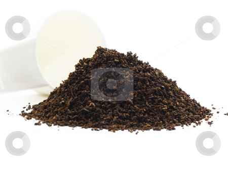 Coffee grounds with scoop stock photo, Coffee grounds with scoop on white background by John Teeter