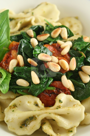 Pasta With Pine Nuts 3 stock photo, Pasta with pesto and spinach, cherry tomatoes and pine nuts. by Brett Mulcahy