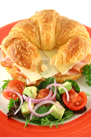 Ham And Cheese Croissant stock photo, Delicious ham and cheddar cheese croissant with salad. by Brett Mulcahy