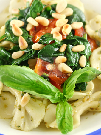 Pasta With Pine Nuts stock photo, Pasta with pesto and spinach, cherry tomatoes and pine nuts. by Brett Mulcahy