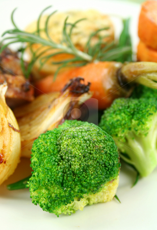 Broccoli And Baked Vegetables stock photo, Broccoli with a sprig of rosemary with baked carrots, onions and sweet potato. by Brett Mulcahy
