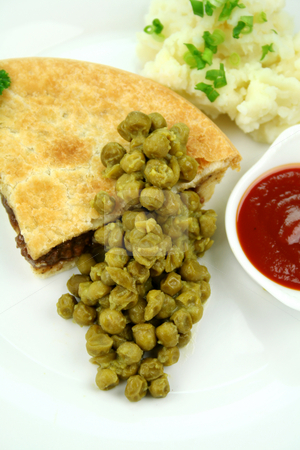Pie With Mushy Peas stock photo, Meat pie with mushy peas and mashed potato and ketchup. by Brett Mulcahy